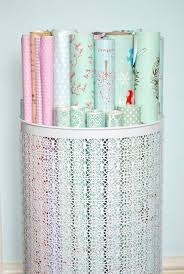 storing wrapping paper use a decorative laundry basket to organize wrapping paper wrap