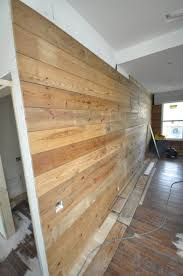 Distressed Wood Wall Panels by Barn Wood Wall Ideas 21 Most Unique Wood Home Decor Ideas