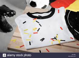 German Flag Shirt Football Shirt Pants And Shoes On Bench With German Flag Studio