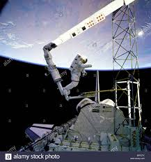 space shuttle astronaut nasa astronaut standing on space shuttle robot arm stock photo