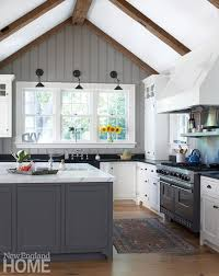 vaulted kitchen ceiling ideas wood beams and painted beadboard emphasize the vaulting of the