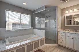 contemporary bathroom with drop in bathtub frameless