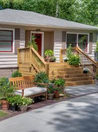 design house exterior lighting photos hgtv neutral home exterior with wooden deck and bench haammss
