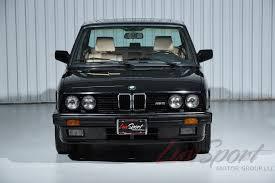1988 bmw e28 m5 sedan in schwarz black metallic over natural tan