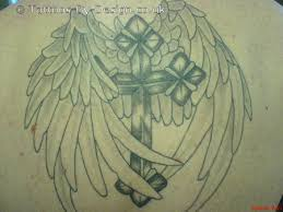 agels rossy cross with wings tattoos