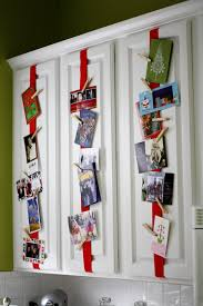 good idea for christmas cards attach ribbon to kitchen cabinets