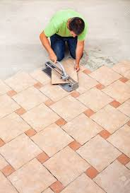 Laying Ceramic Floor Tile Laying Ceramic Floor Tiles Top View With Copy Space Stock