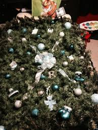 baby grave blanket decorated with ornaments picked by family