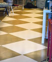 down to earth style cement diamond painted floors and shop pics