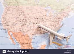 Map Of United States Of America by Miniature Of A Passenger Airplane Flying On The Map Of United