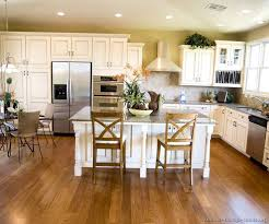 white kitchen cabinets with hardwood floors cherry wood floors