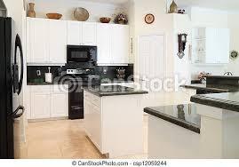 white kitchen cabinets with green granite countertops kitchen