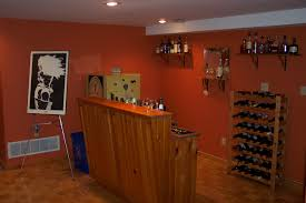 cool orange accents wall paint of home basement bar designs idea