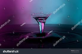 martini purple water drop capture shape martini glass stock photo 527879077