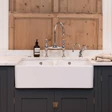 belfast sink in modern kitchen devol kitchen double apron front sink with classic bridge faucet