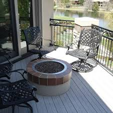 gas fire pit with black fire rocks archadeck outdoor living