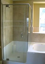 bathroom bathroom with frameless shower doors plus white bath up