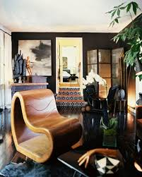 an elegantly moody bachelor pad home tour lonny to acheive a masculine streamlined look straus ebonized his hardwood floors and painted three