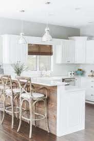 20 gorgeous ways to add reclaimed wood to your kitchen kitchen island covered in reclaimed wood brings contrast to the polished kitchen design de