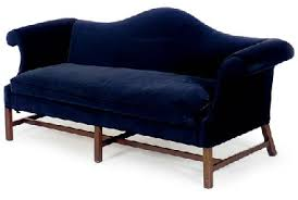 a pair of blue velvet upholstered camel back sofas second half