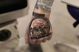 hand skull tattoo best tattoo design ideas