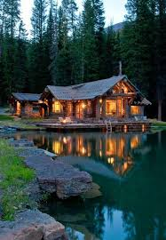 beautiful wooden house in the forest on the lake a house