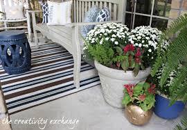 front porch decor ideas fall front porch fluff sprayed gold pumpkin buckets