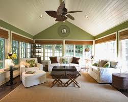 family room ceiling fan sunroom traditional with sloped ceiling