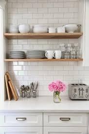 glass shelves for kitchen cabinets floating wooden shelves white subway tile backsplash white wooden