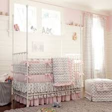 white wooden baby crib and brown rug on ceramics flooring plus