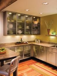 White Kitchen Features Open Shelving Filled With Pottery Over A A - Kitchen cabinets with frosted glass doors