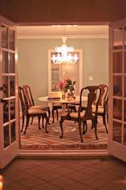 102 best dining rooms images on pinterest dining room designer kristi bender s dining room lit for an evening party with white saarinen tulip table and