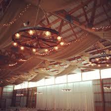 wagon wheel light fixture wagon wheel chandelier pinteres