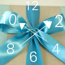 tying gift bows how to tie the bow in gift wrapping means