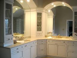corner vanity cabinet bathroom transitional with bathroom light