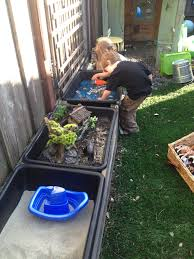 water sand tables along the fence source unknown ece infant