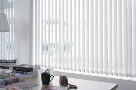 vertical blinds add a simple yet stunning look to any window
