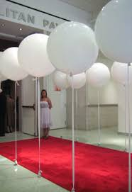 large white balloons rows of large stationary white balloons attached to rigid ribbons