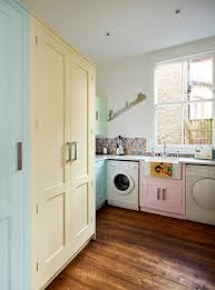 a harvey jones shaker utility room handpainted in multiple