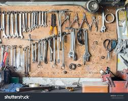tools hanging on wall workshop stock photo 437256484