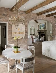brick arch dining room shabby chic style with chandelier white