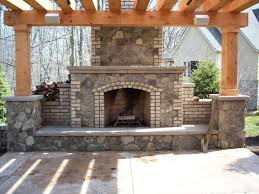outdoor brick fireplace with stacked grey stone and shelf also