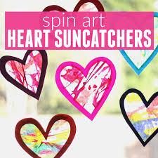 toddler approved spin art heart suncatchers