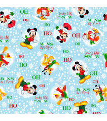 mickey mouse christmas wrapping paper inspirations fabric christmas mickey looks like snow joann