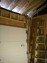 Ceiling Mount Door Track by My Story Modifying Garage Door To Follow Roof Pitch The Garage