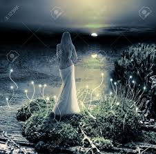 Mermaid Fairy Fairy Or Mermaid Standing On Green Island In Lake And Watching