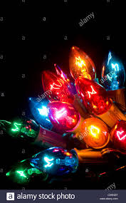 black colored christmas lights brightly colored christmas lights on a black background stock photo