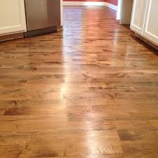 hardwood floor refinish project with brown stain on