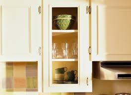 glass kitchen cupboard shelves 9 ways to make your kitchen look and feel bigger bob vila