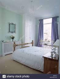 Green And White Duvet White Duvet On Bed In Pastel Green Bedroom With Fretwork Radiator